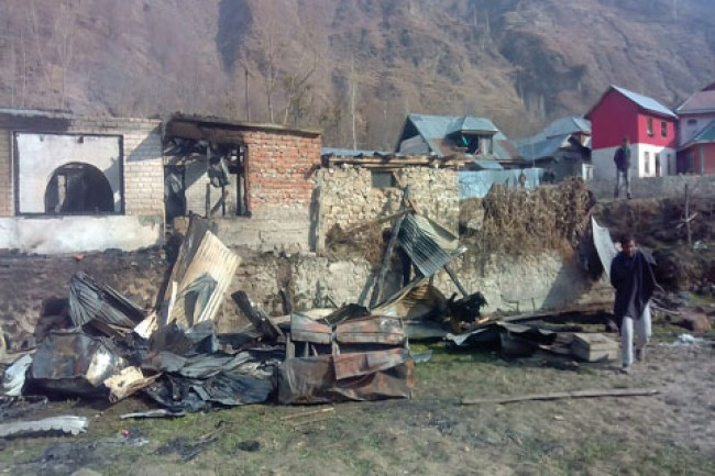 Windstorm uproots trees, damages houses in north Kashmir