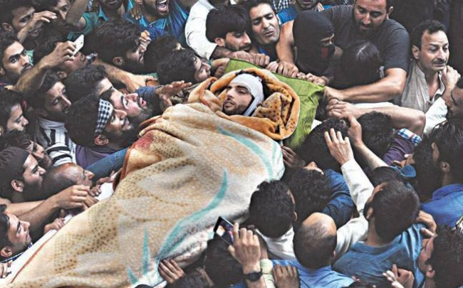 Burhan Wani anniversary: Militants appear at his grave in Tral, offer gun salute