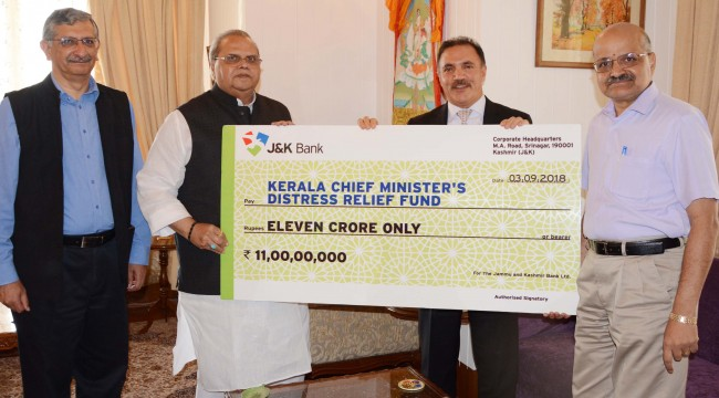 J&K bank chairman hands over 11 crore cheque to Kerala flood victims